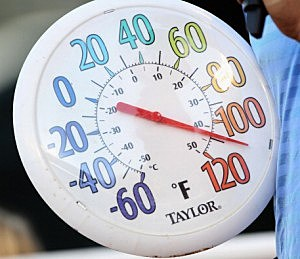 A thermometer shows temperature at over 100 degrees