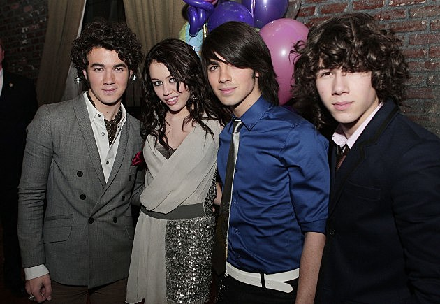 Miley Cyrus and Jonas Brothers