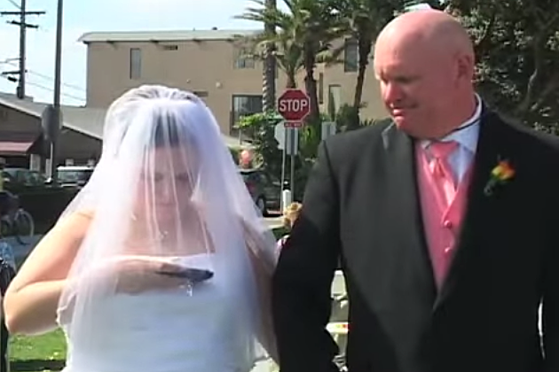 Bride checks phone during wedding