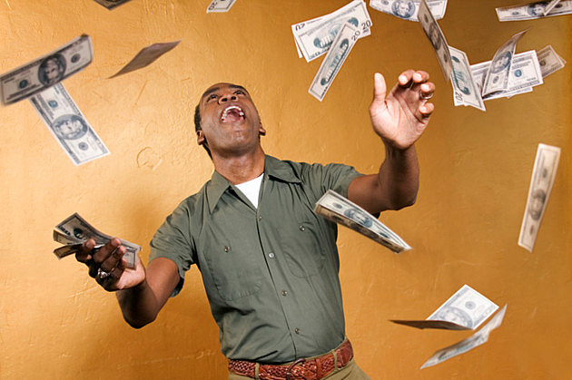 Man catching falling cash