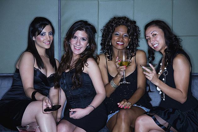 Women drinking cocktails in nightclub